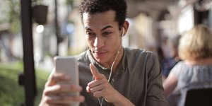 Young man using smartphone.jpg